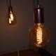 De klant heeft gekozen voor drie grote kooldraad lampen